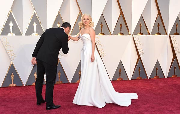 <div class='meta'><div class='origin-logo' data-origin='AP'></div><span class='caption-text' data-credit='Jordan Strauss/Invision/AP'>Lady Gaga and her fiance, actor Taylor Kinney, arrive at the Oscars on Sunday, Feb. 28, 2016, at the Dolby Theatre in Los Angeles.</span></div>