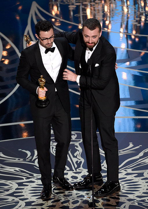<div class='meta'><div class='origin-logo' data-origin='AP'></div><span class='caption-text' data-credit='Chris Pizzello/Invision/AP'>Jimmy Napes, left, and Sam Smith accept the award for best original song for &#34;Writing's On The Wall&#34; from &#34;Spectre at the Oscars on Sunday, Feb. 28, 2016, at the Dolby Theatre.</span></div>