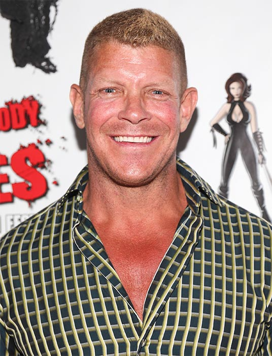 <div class='meta'><div class='origin-logo' data-origin='none'></div><span class='caption-text' data-credit='Imeh Akpanudosen/Getty'>Lee Reherman, athlete and star on &#34;American Gladiators, died on Mar. 2, 2016. He was 49.</span></div>