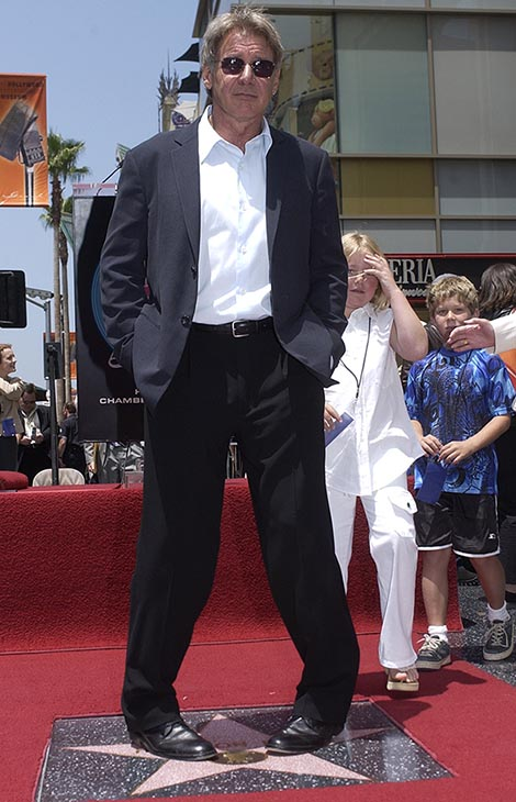 <div class='meta'><div class='origin-logo' data-origin='AP'></div><span class='caption-text' data-credit=''>Actor Harrison Ford stands on his new star on the Hollywood Walk of Fame after a ceremony honoring the actor Friday, May 31, 2003, in Los Angeles.</span></div>