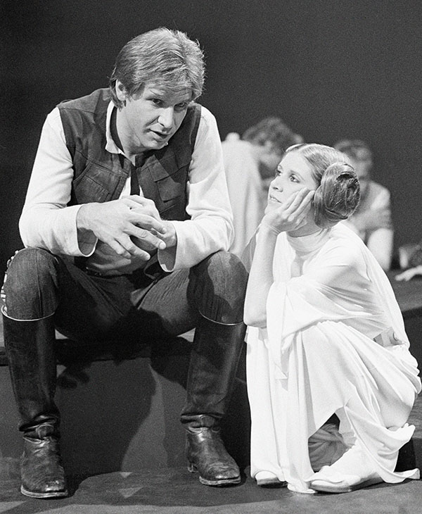 <div class='meta'><div class='origin-logo' data-origin='AP'></div><span class='caption-text' data-credit=''>Harrison Ford, as Han Solo of &#34;Star Wars&#34; fame chats with Carrie Fisher Nov. 13, 1978 during a break in the filming of the CBS-TV special &#34;The Star Wars Holiday.&#34;</span></div>