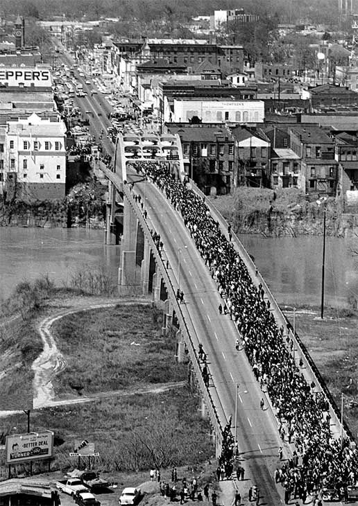 "<div class=""meta image-caption""><div class=""origin-logo origin-image none""><span>none</span></div><span class=""caption-text"">March 21: Dr. Martin Luther King Jr. leads demonstrators cross the Alabama River on the Edmund Pettus Bridge at Selma, Ala. at the start of a five day, 50-mile march. (Photo/AP Photo)</span></div>"