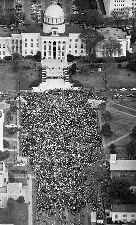 "<div class=""meta image-caption""><div class=""origin-logo origin-image none""><span>none</span></div><span class=""caption-text"">March 25: civil rights marchers in front of the Alabama State Capitol at the end of their 5-day march from Selma to protest discrimination in the state's voting practices. (Photo/AP Photo)</span></div>"