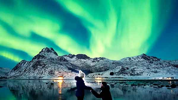 <div class='meta'><div class='origin-logo' data-origin='Creative Content'></div><span class='caption-text' data-credit='Dale Sharpe and Karlie Russell/DK Photography'>Dale Sharpe proposes to Karlie Russell under stunning Northern Lights in Lofoten, Norway.</span></div>