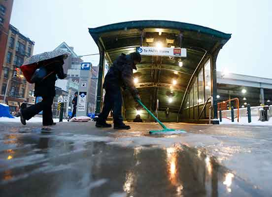"<div class=""meta image-caption""><div class=""origin-logo origin-image kgo""><span>kgo</span></div><span class=""caption-text"">A worker uses a squeegee to push snow and rain mixture away from the entrance of the Hoboken PATH train station during a snowstorm, Tuesday, March 14, 2017, in Hoboken, N.J. (AP Photo/Julio Cortez)</span></div>"