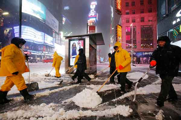 "<div class=""meta image-caption""><div class=""origin-logo origin-image wpvi""><span>wpvi</span></div><span class=""caption-text"">A crew of snow shovelers work as a snowstorm sweeps through Times Square, Tuesday, March 14, 2017, in New York. (AP Photo/Mark Lennihan)</span></div>"