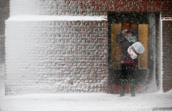 <div class='meta'><div class='origin-logo' data-origin='none'></div><span class='caption-text' data-credit='Michael Dwyer/AP Photo'>A person stands in the wind-driven snow during a winter storm Tuesday, March 14, 2017, in Boston.</span></div>