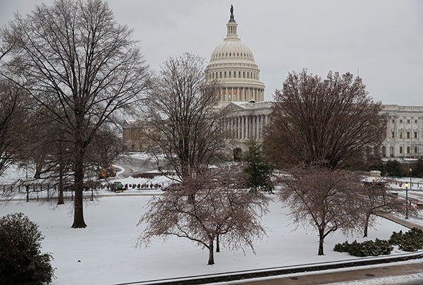 <div class='meta'><div class='origin-logo' data-origin='none'></div><span class='caption-text' data-credit='J. Scott Applewhite/AP Photo'>Snow covers Capitol Hill in Washington, early Tuesday, March, 14, 2017.</span></div>