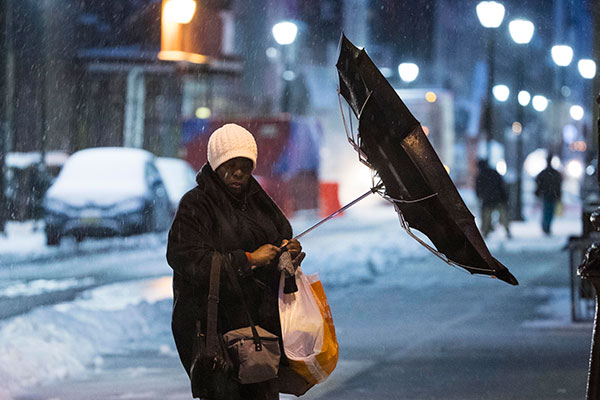 <div class='meta'><div class='origin-logo' data-origin='none'></div><span class='caption-text' data-credit='Matt Rourke/AP Photo'>A woman's umbrella is flipped inside out by the wind during a winter storm in Philadelphia, Tuesday, March 14, 2017.</span></div>
