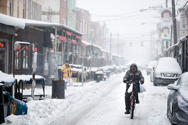 <div class='meta'><div class='origin-logo' data-origin='none'></div><span class='caption-text' data-credit='Matt Rourke/AP Photo'>A man rides his bicycle during a winter storm in the Italian Market neighborhood of Philadelphia, Tuesday, March 14, 2017.</span></div>