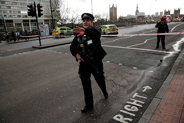 <div class='meta'><div class='origin-logo' data-origin='none'></div><span class='caption-text' data-credit='Matt Dunham/AP Photo'>Police secure the area close to the Houses of Parliament in London, Wednesday, March 22, 201.</span></div>