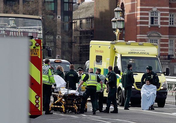 "<div class=""meta image-caption""><div class=""origin-logo origin-image none""><span>none</span></div><span class=""caption-text"">Emergency services staff provide medical attention close to the Houses of Parliament in London, Wednesday, March 22, 2017 (Matt Dunham/AP Photo)</span></div>"