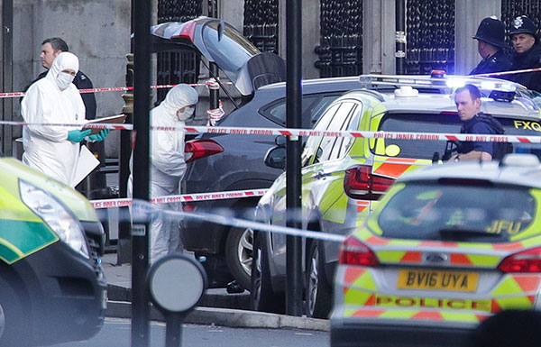 "<div class=""meta image-caption""><div class=""origin-logo origin-image none""><span>none</span></div><span class=""caption-text"">Police forensic officers at the scene close to the Houses of Parliament in London, Wednesday, March 22, 2017. (Yui Mok/PA via AP)</span></div>"