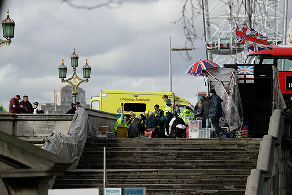 <div class='meta'><div class='origin-logo' data-origin='none'></div><span class='caption-text' data-credit='Matt Dunham/AP Photo'>Emergency services staff provide medical attention close to the Houses of Parliament in London, Wednesday, March 22, 2017.</span></div>