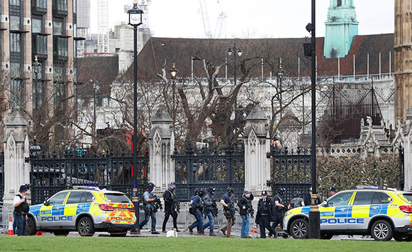 <div class='meta'><div class='origin-logo' data-origin='none'></div><span class='caption-text' data-credit='Kirsty Wigglesworth/AP Photo'>Armed police officers enter the Houses of Parliament in London, Wednesday, March 23, 2017.</span></div>