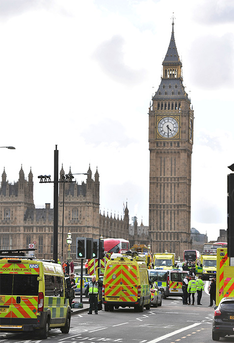 <div class='meta'><div class='origin-logo' data-origin='none'></div><span class='caption-text' data-credit='Dominic Lipinski/PA via AP'>Emergency services on Westminister Bridge after a policeman was stabbed and his apparent attacker shot by officers.</span></div>