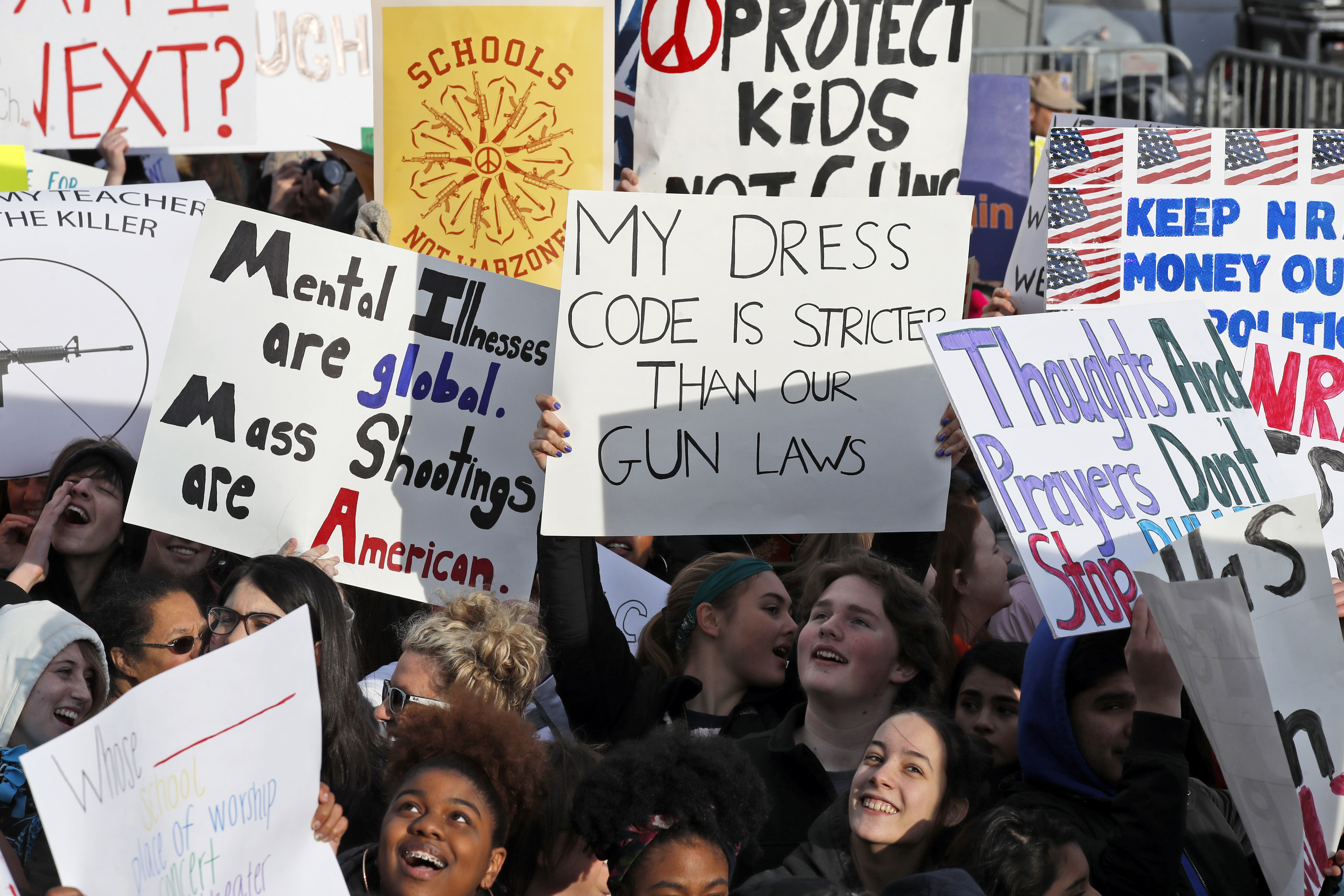 <div class='meta'><div class='origin-logo' data-origin='AP'></div><span class='caption-text' data-credit='AP Photo/Alex Brandon'>Crowds of people hold signs on Pennsylvania Avenue at the &#34;March for Our Lives&#34; rally in support of gun control, Saturday, March 24, 2018, in Washington.</span></div>