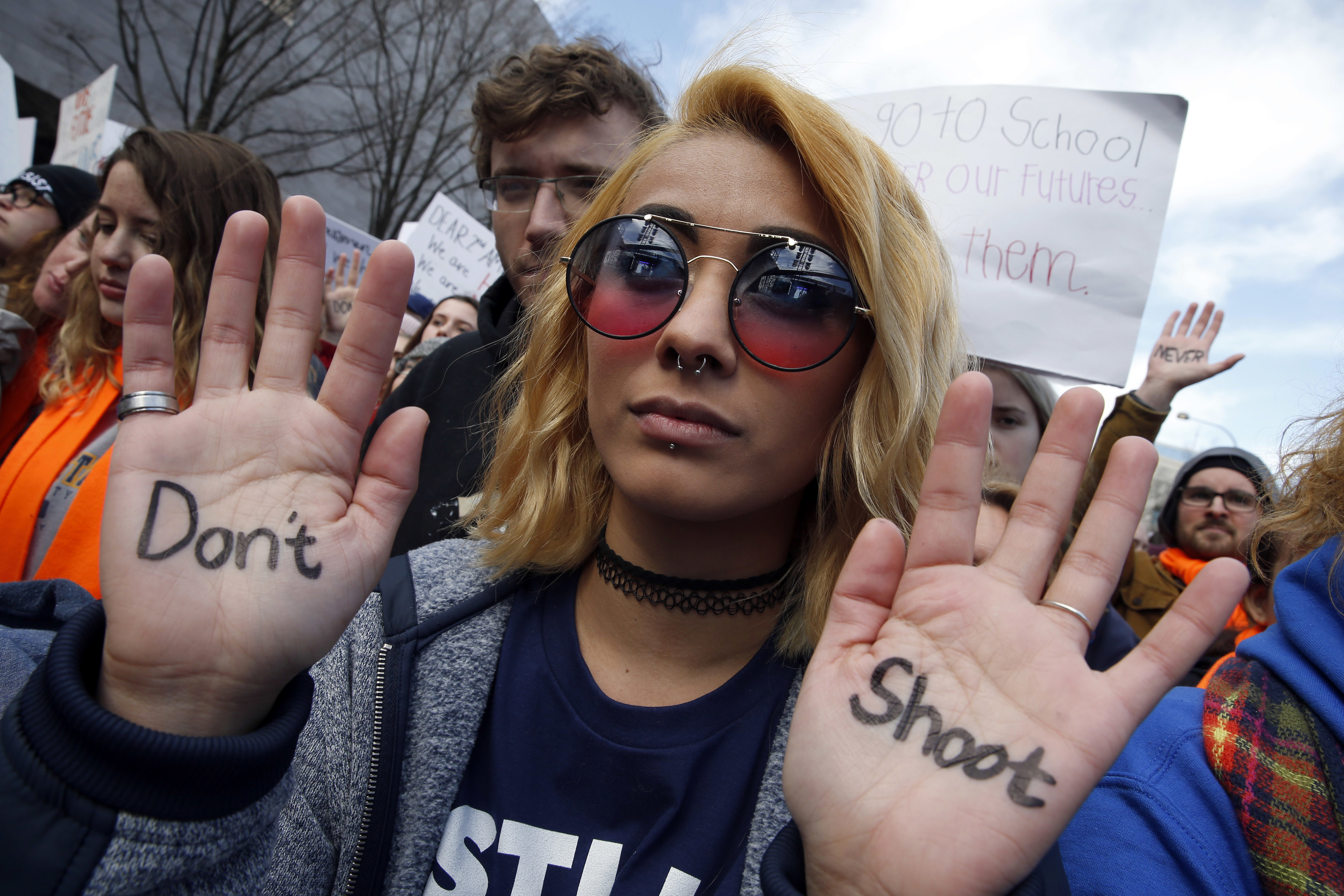 <div class='meta'><div class='origin-logo' data-origin='AP'></div><span class='caption-text' data-credit='AP Photo/Alex Brandon'>Daisy Hernandez, 22, of Stafford, Va., wrote &#34;Don't Shoot,&#34; on her hands during the &#34;March for Our Lives&#34; rally in support of gun control, Saturday, March 24, 2018, in Washington.</span></div>