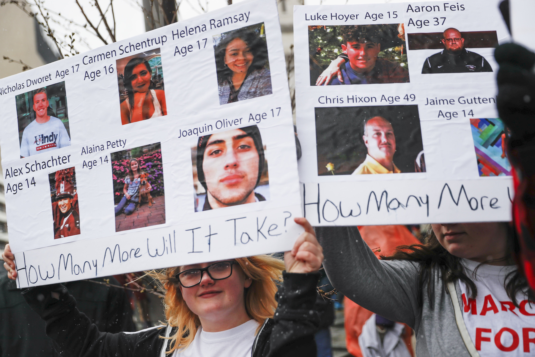 <div class='meta'><div class='origin-logo' data-origin='AP'></div><span class='caption-text' data-credit='AP Photo/John Minchillo'>Shelby Powell, 15, of Newport High School, holds a sign depicting lives lost in school shootings during the March for Our Lives protest in Cincinnati.</span></div>