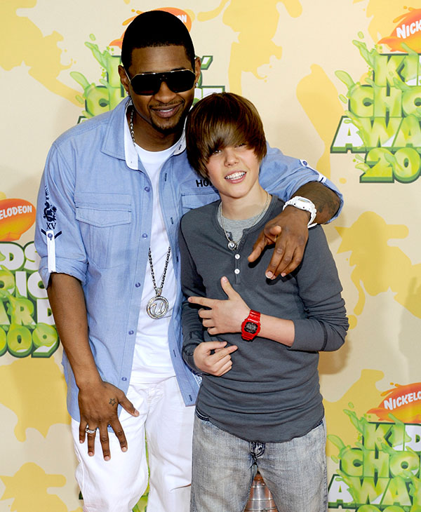 "<div class=""meta image-caption""><div class=""origin-logo origin-image ap""><span>AP</span></div><span class=""caption-text"">Musicians Usher, left, and Justin Bieber arrive at the 22nd Annual Kids' Choice Awards on Saturday, March 28, 2009, in Los Angeles.</span></div>"