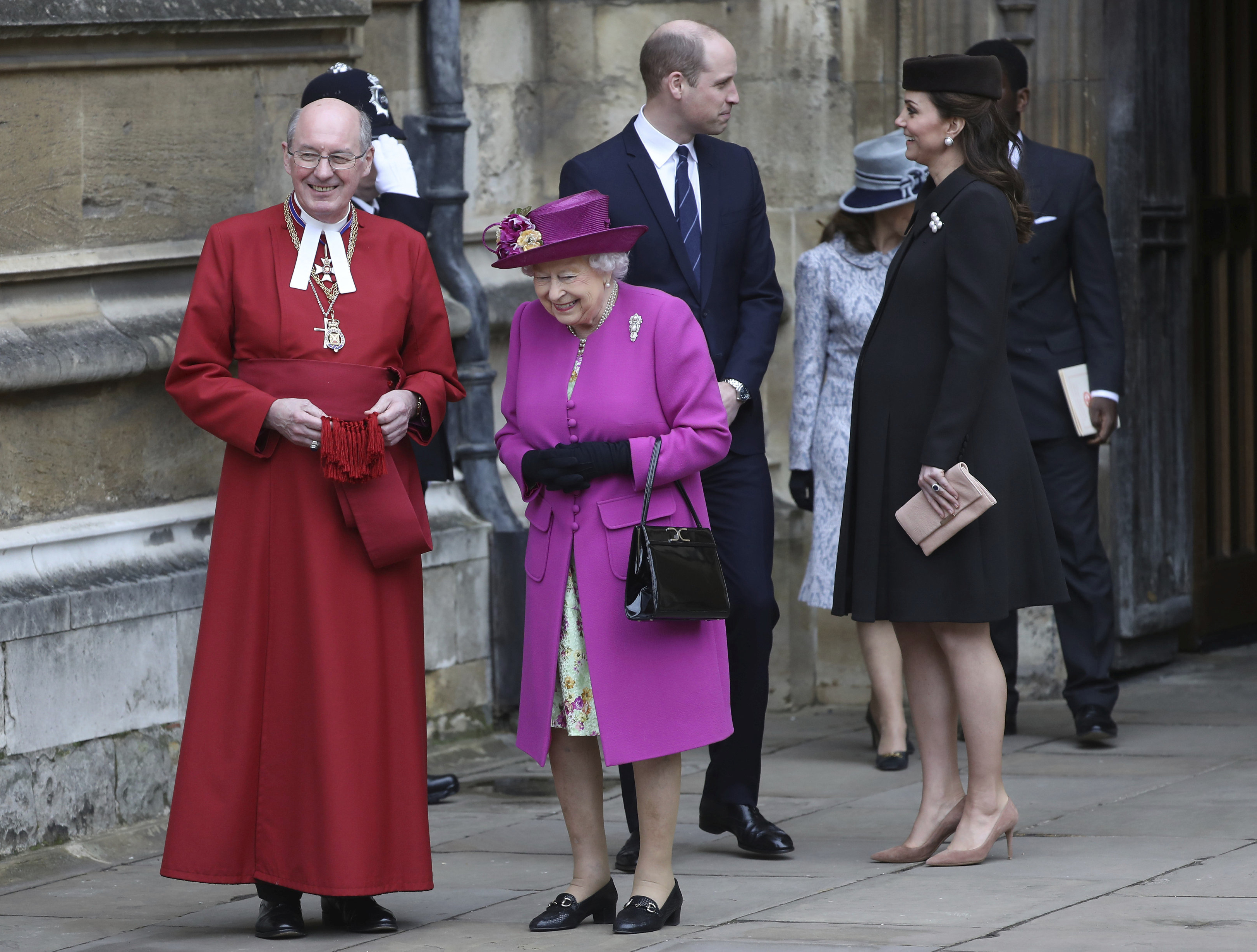 <div class='meta'><div class='origin-logo' data-origin='none'></div><span class='caption-text' data-credit='Simon Dawson/pool via AP'>Queen Elizabeth II, with Prince William and Kate, Duchess of Cambridge, leave the annual Easter Sunday service at St George's Chapel at Windsor Castle in Windsor on April 1, 2018.</span></div>