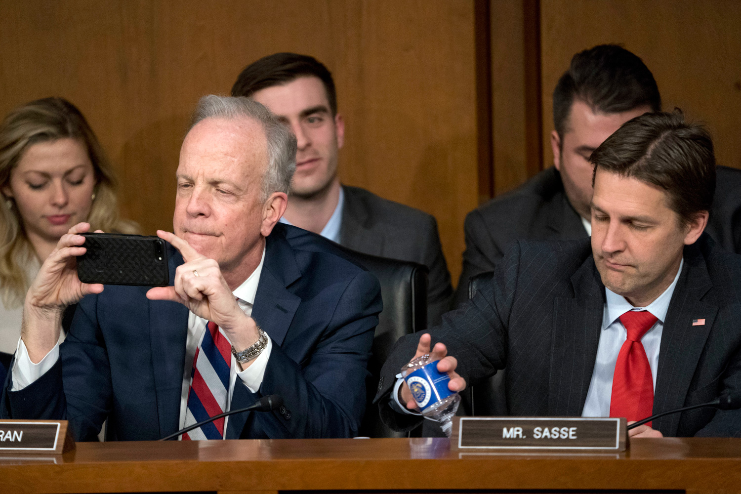 <div class='meta'><div class='origin-logo' data-origin='none'></div><span class='caption-text' data-credit='Andrew Harnik/AP Photo'>Sen. Jerry Moran, R-Kan., left, accompanied by Sen. Ben Sasse, R-Neb., right, takes a photo as Facebook CEO Mark Zuckerberg testifies.</span></div>