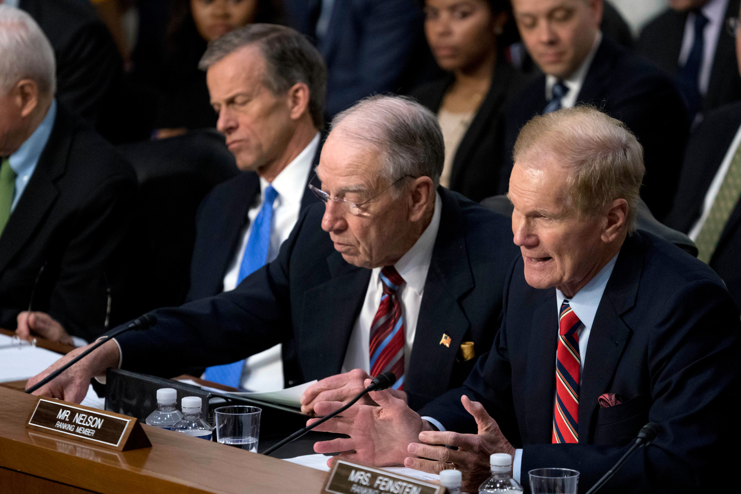 <div class='meta'><div class='origin-logo' data-origin='none'></div><span class='caption-text' data-credit='Andrew Harnik/AP Photo'>Sen. Bill Nelson, D-Fla., right, accompanied by Sen. John Thune, R-S.D., left, and Sen. Chuck Grassley, R-Iowa, second from left, speaks as Facebook CEO Mark Zuckerberg testifies.</span></div>