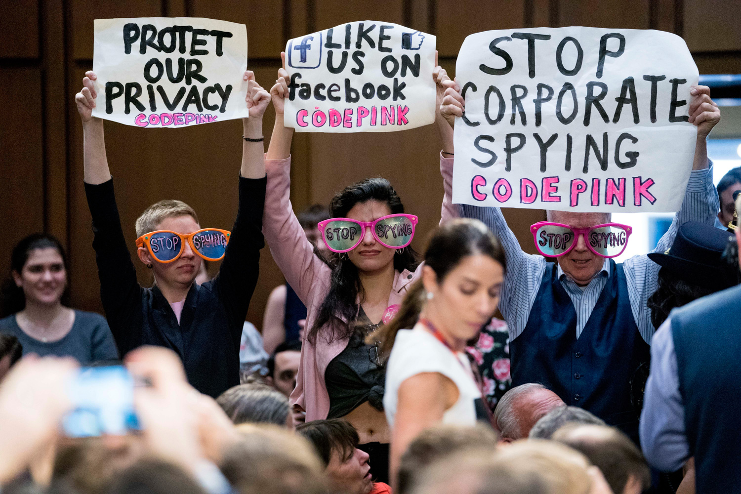 <div class='meta'><div class='origin-logo' data-origin='none'></div><span class='caption-text' data-credit='Andrew Harnik/AP Photo'>Members of the audience hold up signs and wear sunglasses that read &#34;Stop Spying&#34; before CEO Mark Zuckerberg arrives to testify.</span></div>