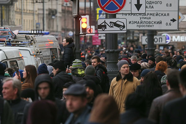 <div class='meta'><div class='origin-logo' data-origin='none'></div><span class='caption-text' data-credit='Alexander DemianchukTASS via Getty Images'>Locals near Tekhnologichesky Institut station of the St Petersburg metro in the aftermath of a blast that hit a train carriage between stations.</span></div>