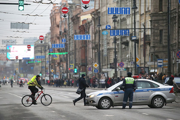 <div class='meta'><div class='origin-logo' data-origin='none'></div><span class='caption-text' data-credit='Peter KovalevTASS via Getty Images'>Traffic police officers are shown near crowds at Moskovsky Prospekt Street near the entrance to Tekhnologichesky Institut station of the St Petersburg metro.</span></div>