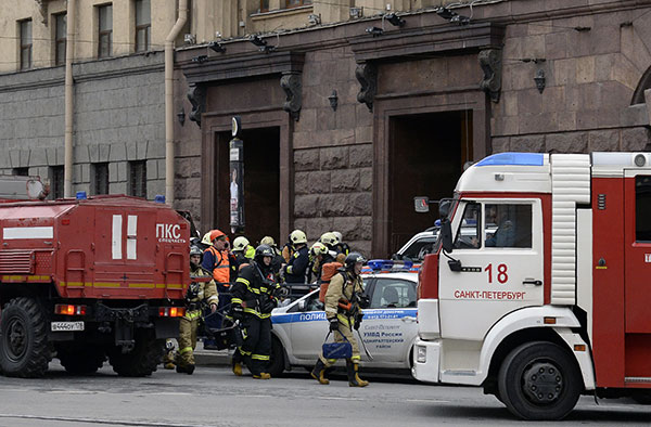 <div class='meta'><div class='origin-logo' data-origin='none'></div><span class='caption-text' data-credit='OLGA MALTSEVA/AFP/Getty Images'>Emergency services personnel walk at the entrance to Technological Institute metro station in Saint Petersburg on April 3, 2017.</span></div>