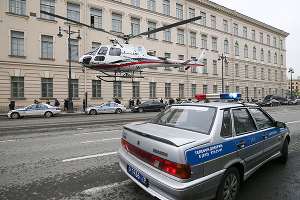 <div class='meta'><div class='origin-logo' data-origin='none'></div><span class='caption-text' data-credit='Peter KovalevTASS via Getty Images'>An emergency service helicopter and a police car near Tekhnologichesky Institut station of the St Petersburg metro in the aftermath of an explosion which occurred in a train.</span></div>