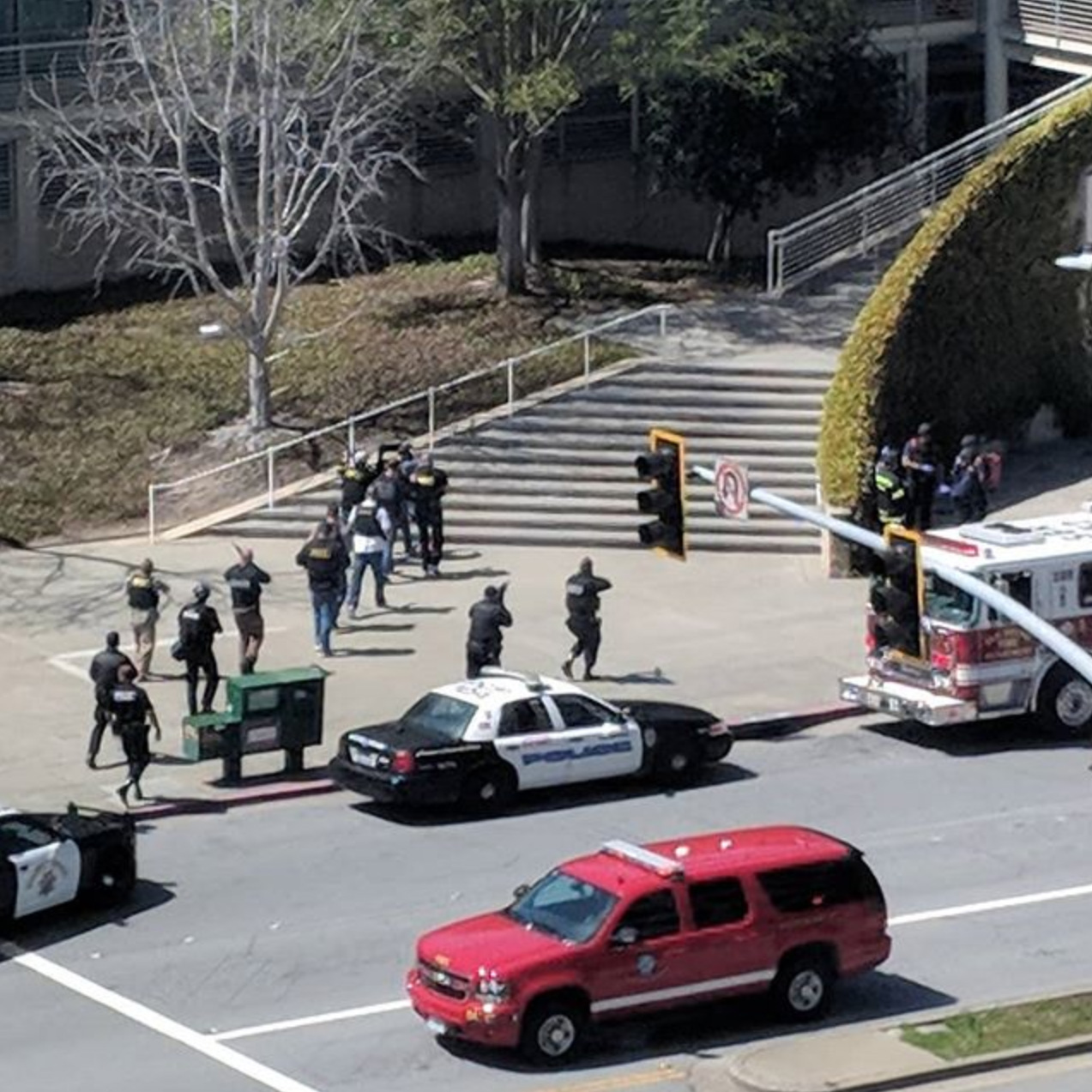 <div class='meta'><div class='origin-logo' data-origin='none'></div><span class='caption-text' data-credit='Justin Sullivan/Getty Images'>Police put on tactical gear outside of the YouTube headquarters on April 3, 2018 in San Bruno, California.</span></div>