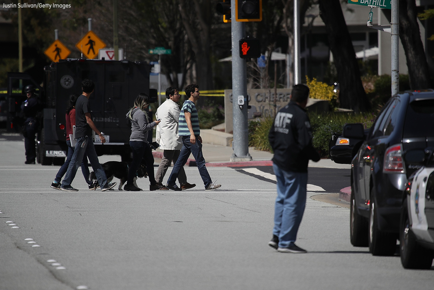 <div class='meta'><div class='origin-logo' data-origin='none'></div><span class='caption-text' data-credit='Justin Sullivan/Getty Images'>Police look on as employees walk across the street outside of the YouTube headquarters on April 3, 2018 in San Bruno, California.</span></div>