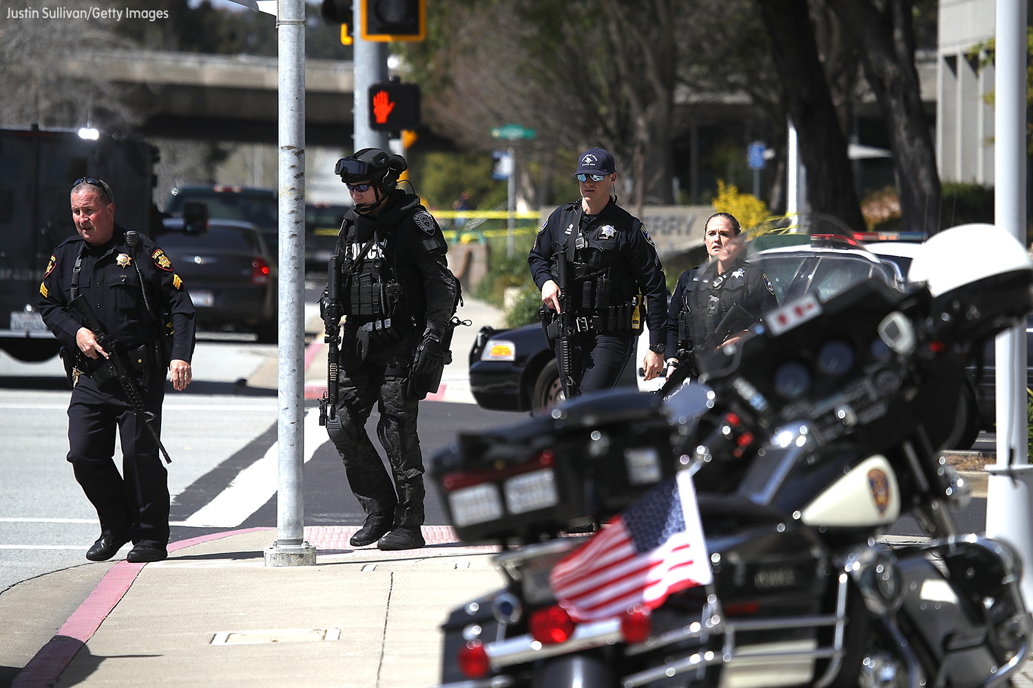 <div class='meta'><div class='origin-logo' data-origin='none'></div><span class='caption-text' data-credit='Justin Sullivan/Getty Images'>Police walk outside of the YouTube headquarters on April 3, 2018 in San Bruno, California.</span></div>