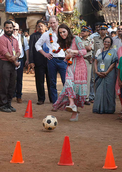 "<div class=""meta image-caption""><div class=""origin-logo origin-image ap""><span>AP</span></div><span class=""caption-text"">Prince William, watches as his wife Kate, the Duchess of Cambridge, plays soccer during their visit to a slum in Mumbai, India, Sunday, April 10, 2016. (Shailesh Andrade /Pool via AP)</span></div>"