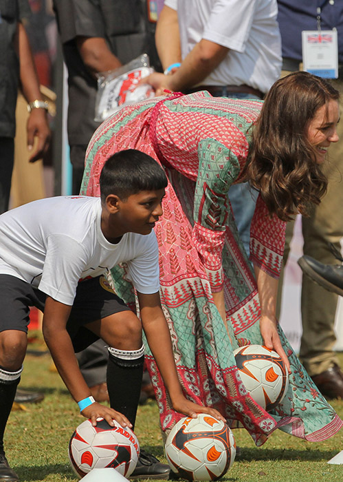 <div class='meta'><div class='origin-logo' data-origin='AP'></div><span class='caption-text' data-credit='Rafiq Maqbool/Pool via AP'>The Duchess of Cambridge, the former Kate Middleton, plays with Indian children during a charity event at the Oval Maidan in Mumbai, India, Sunday, April 10, 2016.</span></div>