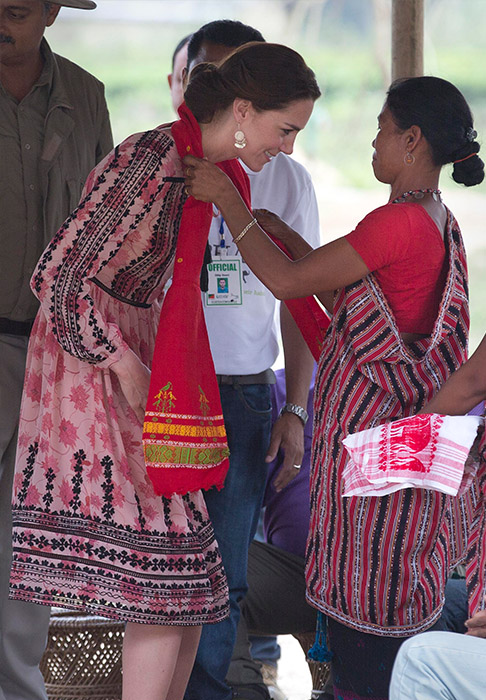 <div class='meta'><div class='origin-logo' data-origin='AP'></div><span class='caption-text' data-credit='Anupam Nath/AP'>Indian villagers facilitate Kate with a Gamocha, a traditional shawl at Panbari village in Kaziranga, east of Gauhati, northeastern Assam state, India, April 13, 2016.</span></div>