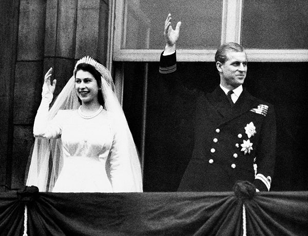 "<div class=""meta image-caption""><div class=""origin-logo origin-image none""><span>none</span></div><span class=""caption-text"">Princess Elizabeth and Prince Philip, Duke of Edinburgh make a charming picture as they wave to the crowds from the balcony of Buckingham Palace on their wedding day in 1947. (AP Photo)</span></div>"