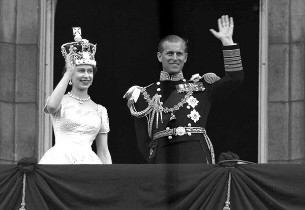 "<div class=""meta image-caption""><div class=""origin-logo origin-image none""><span>none</span></div><span class=""caption-text"">Queen Elizabeth II and Prince Philip wave from the balcony at Buckingham Palace, following her coronation at Westminster Abbey in 1953 (AP Photo/Leslie Priest, File)</span></div>"
