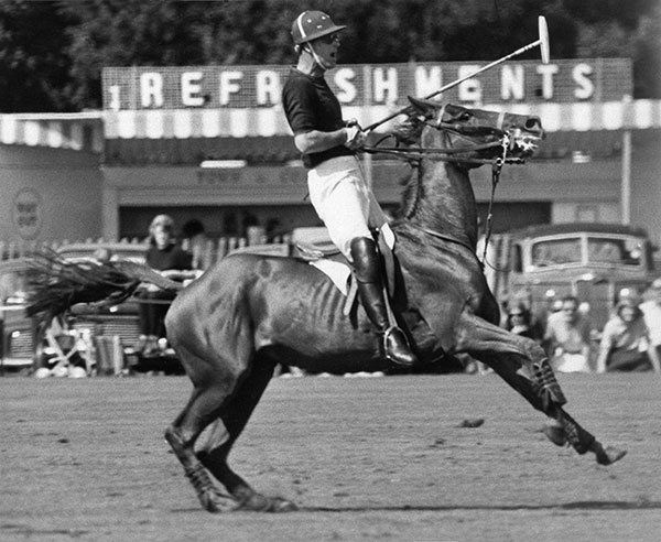 "<div class=""meta image-caption""><div class=""origin-logo origin-image none""><span>none</span></div><span class=""caption-text"">Prince Philip pulls his mount up sharply during a polo match at Windsor, Berkshire in 1965. (AP Photo)</span></div>"