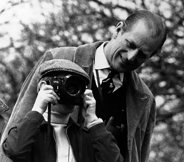 "<div class=""meta image-caption""><div class=""origin-logo origin-image none""><span>none</span></div><span class=""caption-text"">Prince Edward photographs the Badminton Horse Trials in 1976 as his father Prince Philip looks on. (AP Photo)</span></div>"