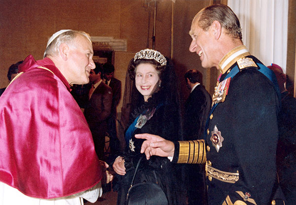 "<div class=""meta image-caption""><div class=""origin-logo origin-image none""><span>none</span></div><span class=""caption-text"">Queen Elizabeth II, turns at smiles at her husband Prince Philip, during an audience with Pope John Paul II in 1980. (AP Photo/Arturo Mari)</span></div>"
