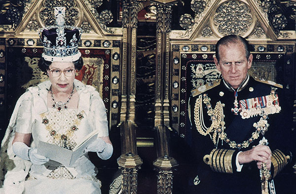 "<div class=""meta image-caption""><div class=""origin-logo origin-image none""><span>none</span></div><span class=""caption-text"">Queen Elizabeth II reads from her statement during the State Opening of Parliament in London in 1986 while Prince Philip listens. (AP Photo)</span></div>"