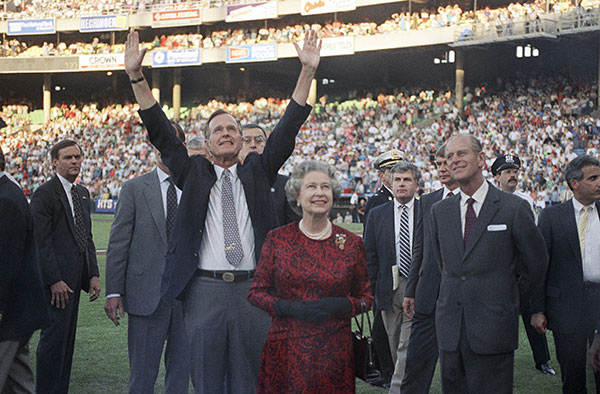 "<div class=""meta image-caption""><div class=""origin-logo origin-image none""><span>none</span></div><span class=""caption-text"">President George H. Bush escorts Queen Elizabeth II and Prince Philip on the field at Memorial Stadium in Baltimore in 1991. It was the Queen's first baseball game. (AP Photo/Greg Gibson)</span></div>"