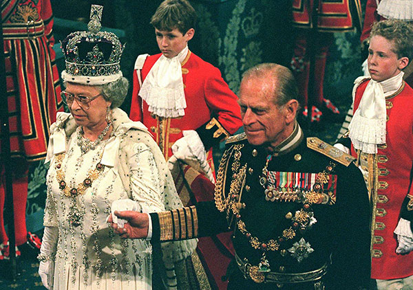 "<div class=""meta image-caption""><div class=""origin-logo origin-image none""><span>none</span></div><span class=""caption-text"">Prince Philip walks with Queen Elizabeth II before her speech in the State Opening of Parliament in 1997. (AP Photo/Gerald Penny, Pool)</span></div>"