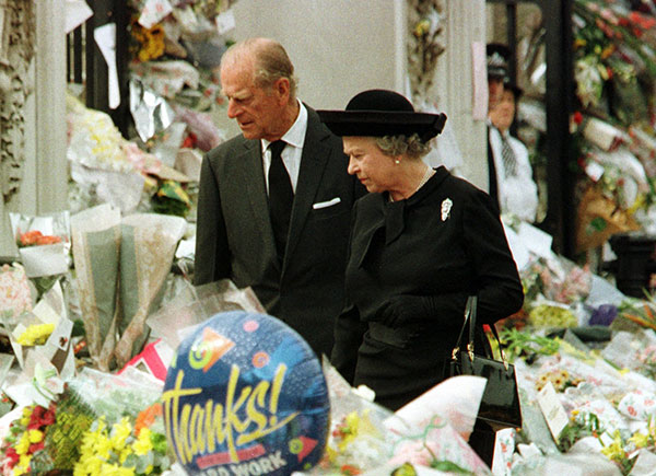 "<div class=""meta image-caption""><div class=""origin-logo origin-image none""><span>none</span></div><span class=""caption-text"">Queen Elizabeth II and her husband the Duke of Edinburgh, Prince Philip, view some of the numerous tributes to Diana, Princess of Wales, after her death in 1997. (AP Photo/Pool)</span></div>"