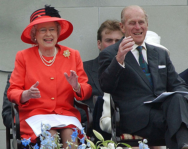 "<div class=""meta image-caption""><div class=""origin-logo origin-image none""><span>none</span></div><span class=""caption-text"">Queen Elizabeth II laughs with her husband, Prince Philip, as they watch a parade in The Mall in London as part of the Golden Jubilee celebrations in 2002. (AP Photo/Rebecca Naden/pool)</span></div>"