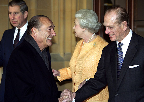 "<div class=""meta image-caption""><div class=""origin-logo origin-image none""><span>none</span></div><span class=""caption-text"">French President Jacques Chirac, center left, bids farewell to Prince Philip, right, after Chirac visited in 2004. (AP Photo/Adrian Dennis, Pool)</span></div>"