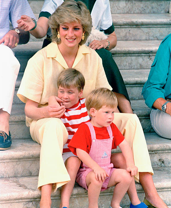 <div class='meta'><div class='origin-logo' data-origin='AP'></div><span class='caption-text' data-credit='AP'>Princess Diana of Wales smiles as she sits with her sons, Princes Harry and William, on the steps of the Royal Palace on the island of Majorca, Spain, Aug. 9, 1987.</span></div>